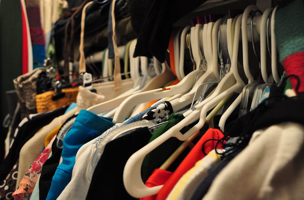 Messy closet that's full of clothing